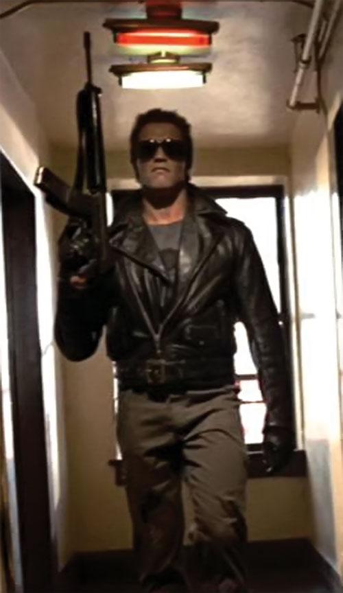 The Terminator (Arnold Schwarzenegger) with an assault rifle in a corridor