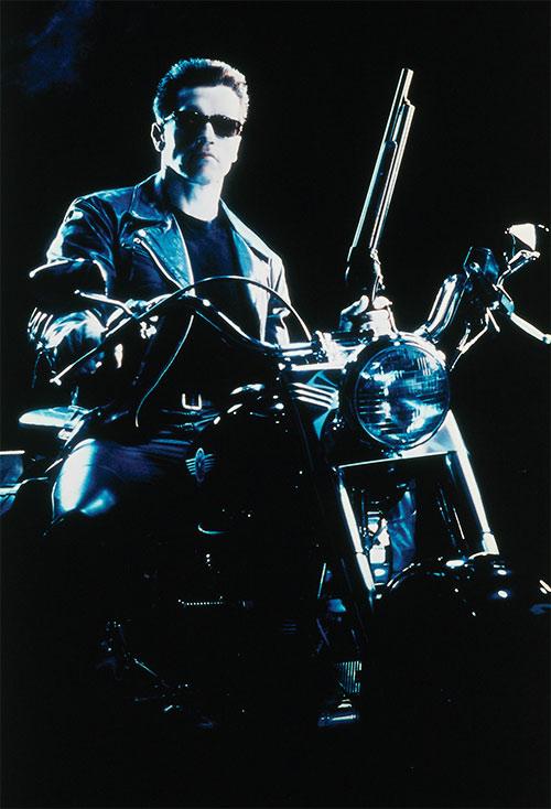 The Terminator (Arnold Schwarzenegger) with motorbike and shotgun