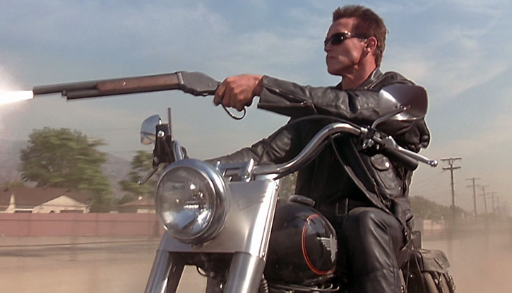 T-800 Terminator firing his Winchester while riding a motorbike