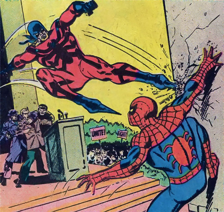 Tarantula (Anton Rodriquez) attacks Spider-Man during an university protest