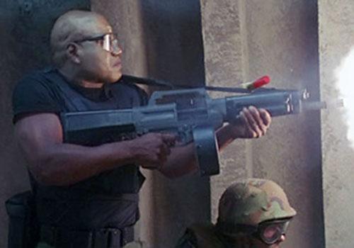 Teal'C (Christopher Judge in Stargate) firing an USAS shotgun