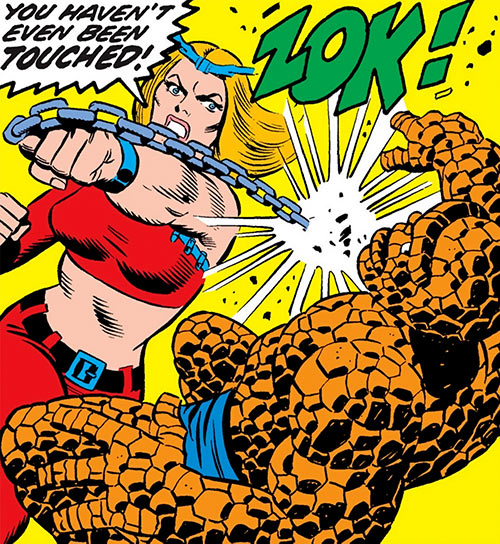 Thundra (Marvel Comics) punches the Thing