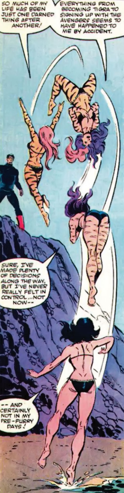 Tigra of the Avengers West Coast (Marvel Comics) does a back flip while changing forms