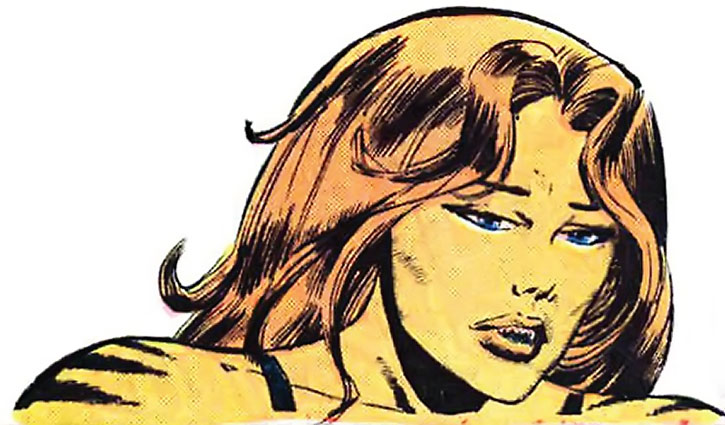 Tigra (Greer Nelson) looking bereft, over a white background