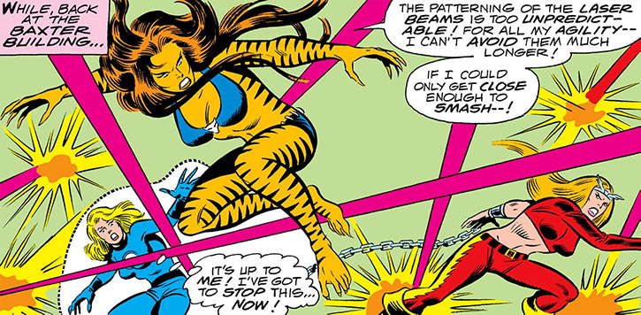 Tigra (Greer Nelson) dodging lasers