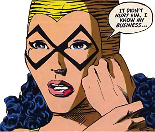 Tigress of the Young All-Stars (DC Comics) (Brooks) face closeup rubbing her wrist