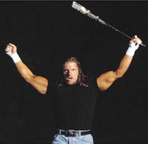 Triple H brandishing a bat