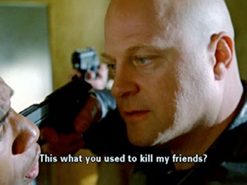 Vic Mackey (Michael Chiklis in The Shield) shoving a pistol into a man's face