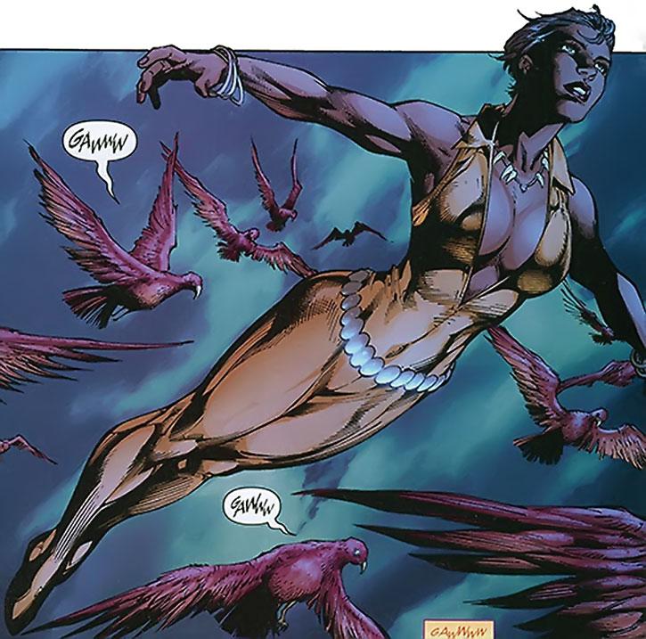 Vixen (Mari McCabe) flying among red birds