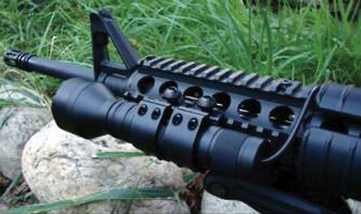Huge tactical flashlight on assault carbine