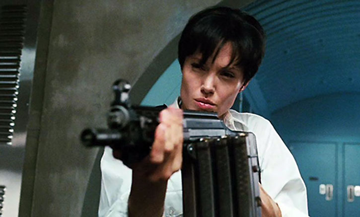 Angelina Jolie fires an assault rifle with stacked magazines