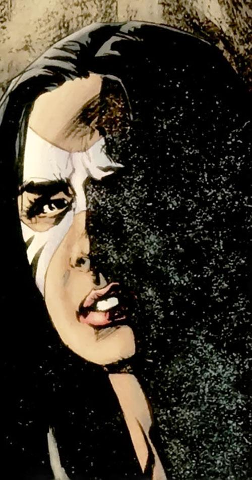 White Tiger (Angela del Toro) (Marvel Comics) face closeup in shadows