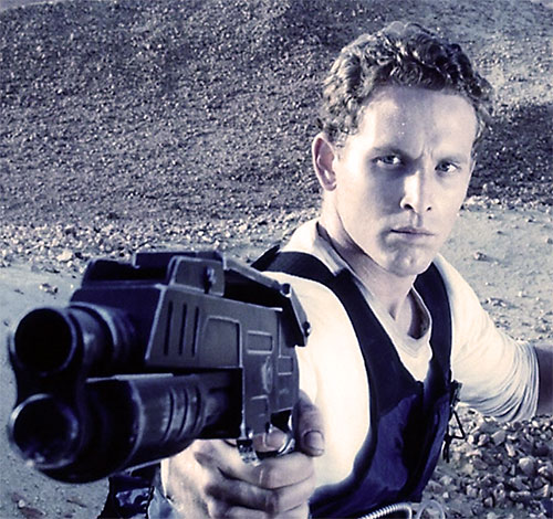 William Johns (Cole Hauser in Pitch Black) pointing his shotgun