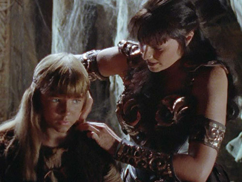 Xena (Lucy Lawless) and a girl