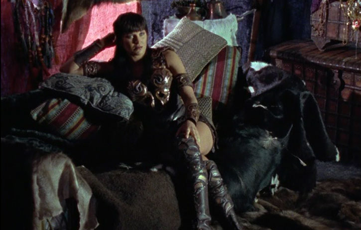 Xena (Lucy Lawless) on a couch