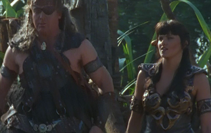 Xena (Lucy Lawless) and a very big guy