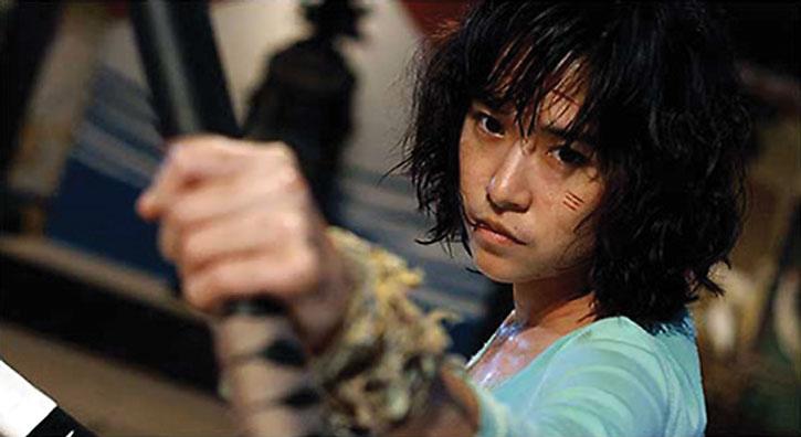 Zen (Jeeja Vismistananda) wields a sword ; face closeup