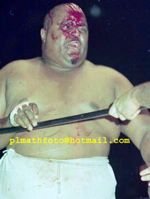 Abdullah the Butcher with a bloody face