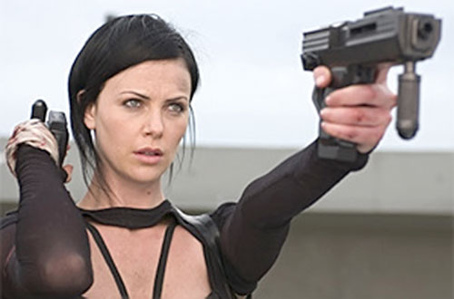 Aeon Flux (Charlize Theron) aims a machine pistol