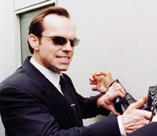 Agent Smith (Hugo Weaving in the Matrix) grabbing a human