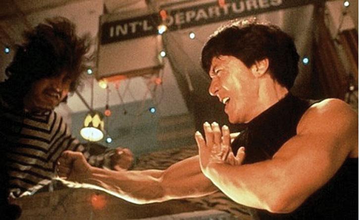 Ah Keung (Jackie Chan) punching a mook