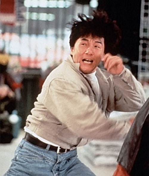 Ah Keung (Jackie Chan in Rumble in the Bronx) fighting in a beige jacket
