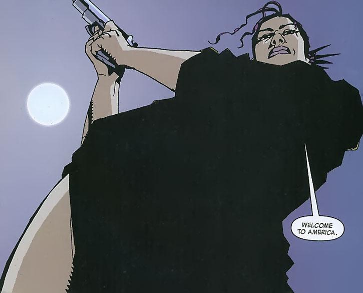 Aisha cocking her pistol