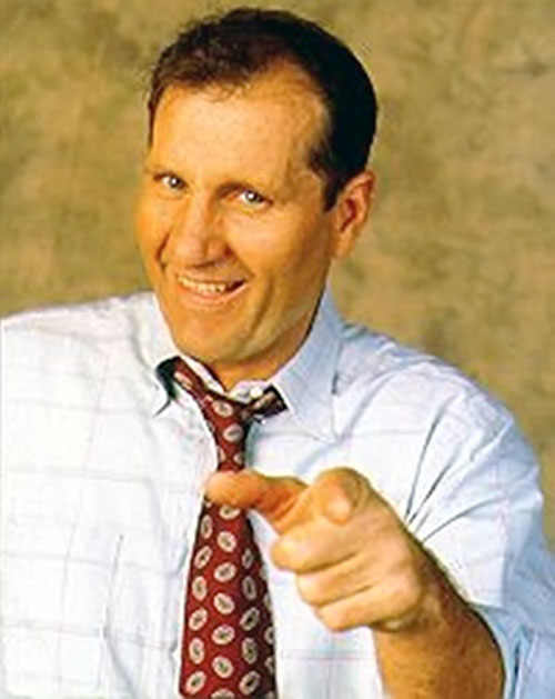 Al Bundy (Ed O'Neill in Married with Children) pointing and smiling