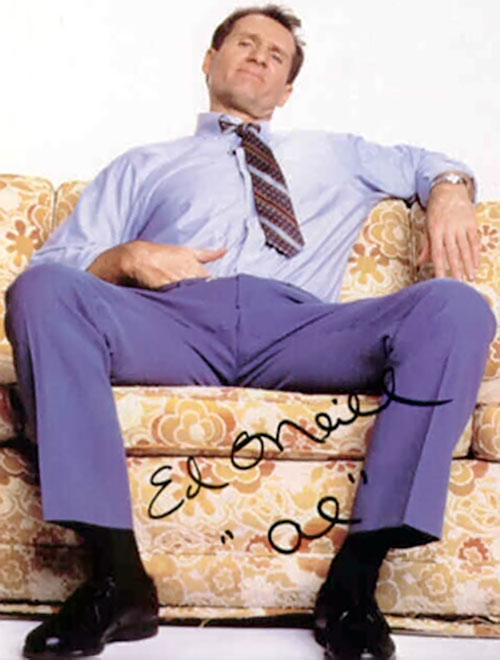 Al Bundy (Ed O'Neill in Married with Children) sitting with a hand in his pants