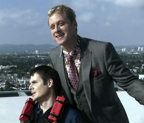 Alpha (Alan Tudyk in Dollhouse) with hostage on rooftop
