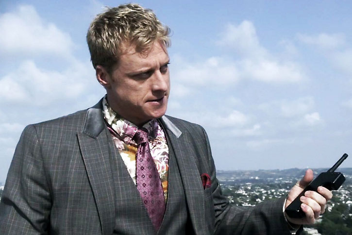 Alpha (Alan Tudyk) on a rooftop