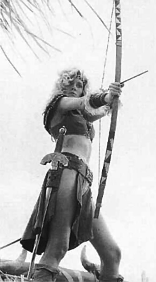 Amethea (Lana Clarkson in Barbarian Queen) with a bow