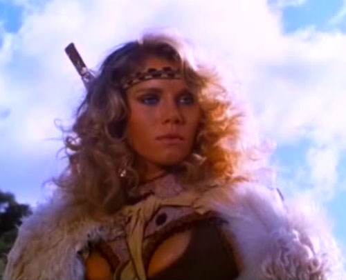 Amethea (Lana Clarkson in Barbarian Queen) with headband and fur cloak