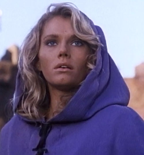 Amethea (Lana Clarkson in Barbarian Queen) face closeup with purple hooded cloak