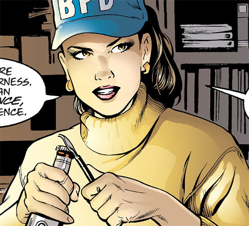 Amy Rohrbach (Nightwing character) (DC Comics) with a police cap and a yellow sweater