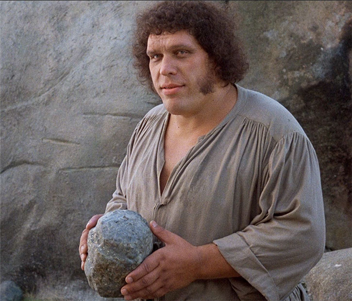 Andre the Giant as Fezzik in The Princess Bride, with a big rock