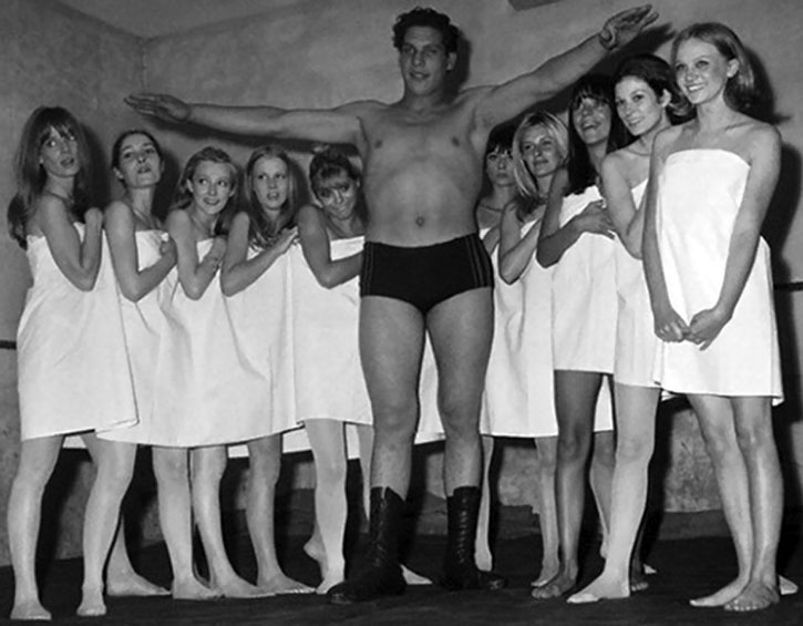 A young Andre the Giant poses with models