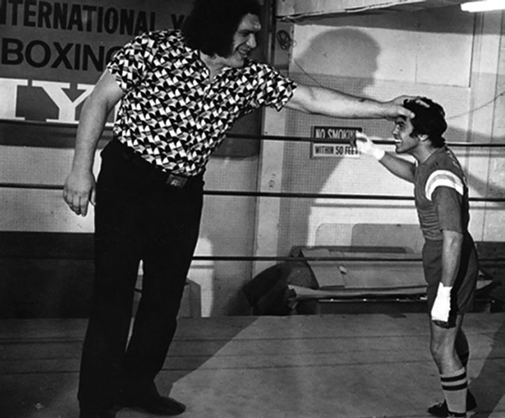 Andre the Giant holds a boxer at bay