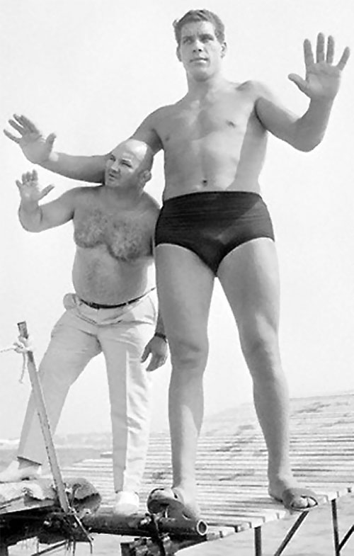 Andre the Giant (wrestler) with another French wrestler near the sea
