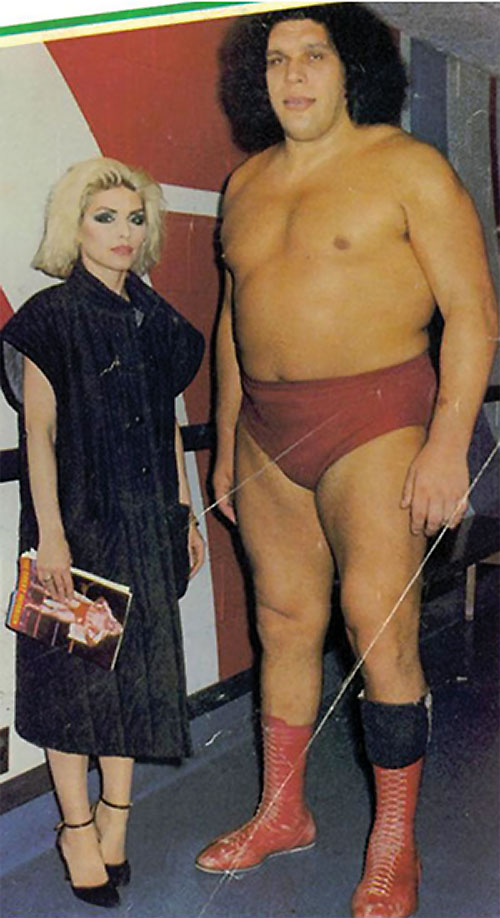 Andre the Giant (wrestler) with a fashionable woman