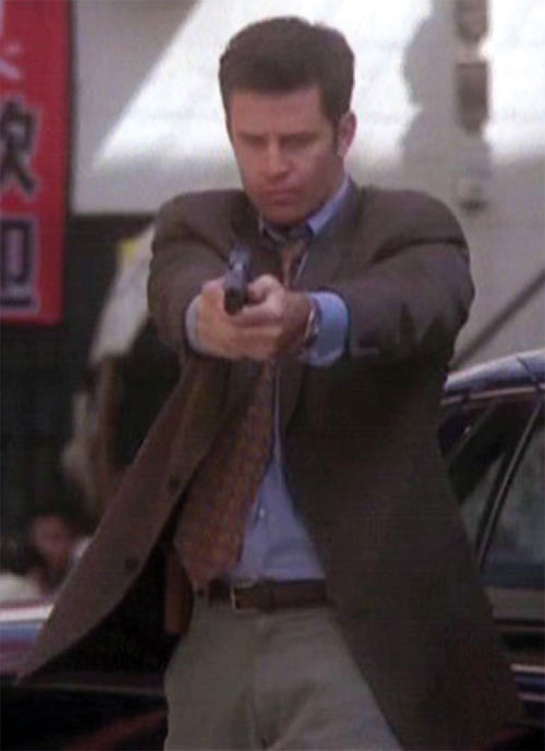Andy Trudeaux (Ted King in Charmed) aiming his pistol