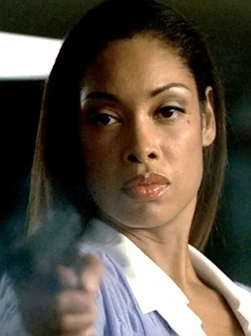 Anna Espinosa (Gina Torres in Alias) pointing a pistol