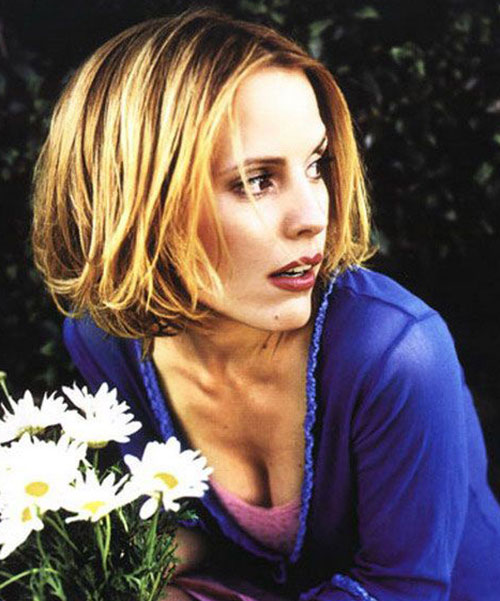 Anya (Emma Caulfield in Buffy) with flowers
