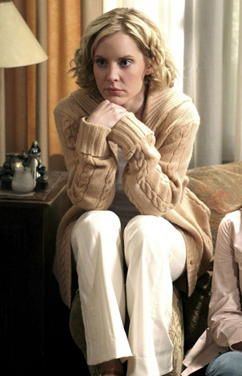 Anya (Emma Caulfield in Buffy) with a beige knitted vest