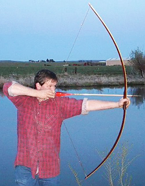 Longbow hunter near a river