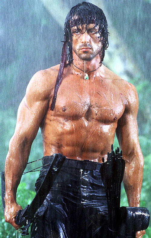 Sylvester Stallone as Rambo, bare-chested with a compound bow