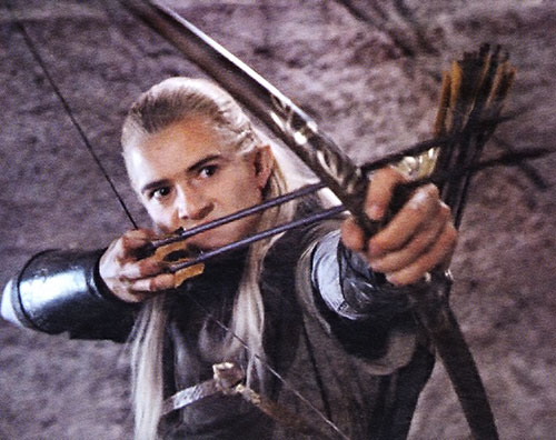 Orlando Bloom as Legolas aiming a pair of arrows