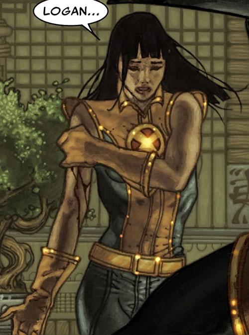 Armor of the X-Men (Hisako Ichiki) (Marvel Comics) holding her wounded arm