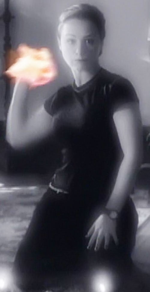 Aviva (Danielle Harris in Charmed) with her hand on fire