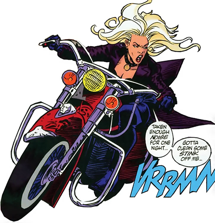 Barb Wire rides away on her bike
